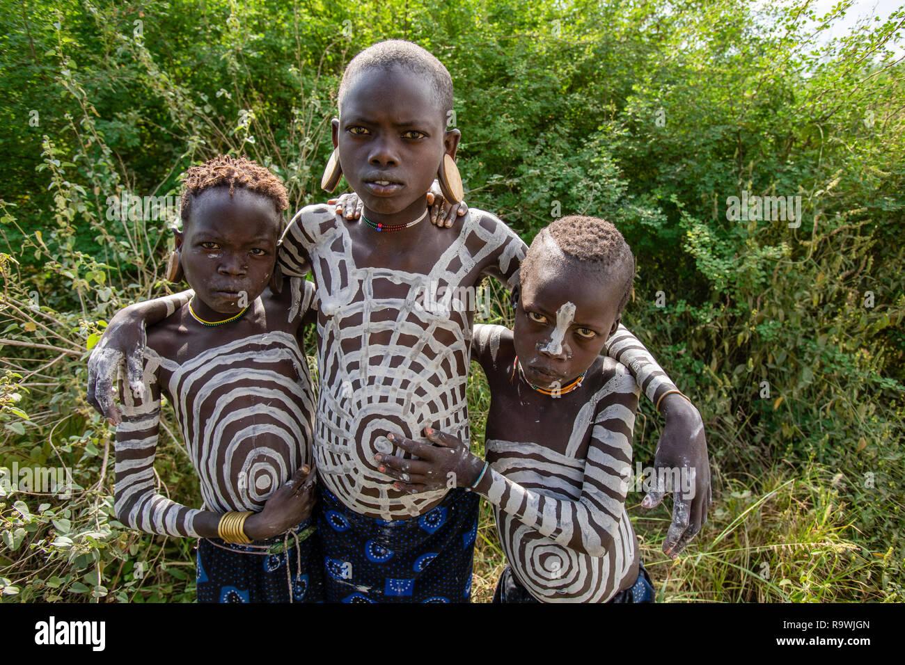 Mursi Tribe boys of Omo Valley, Ethiopia - Stock Image