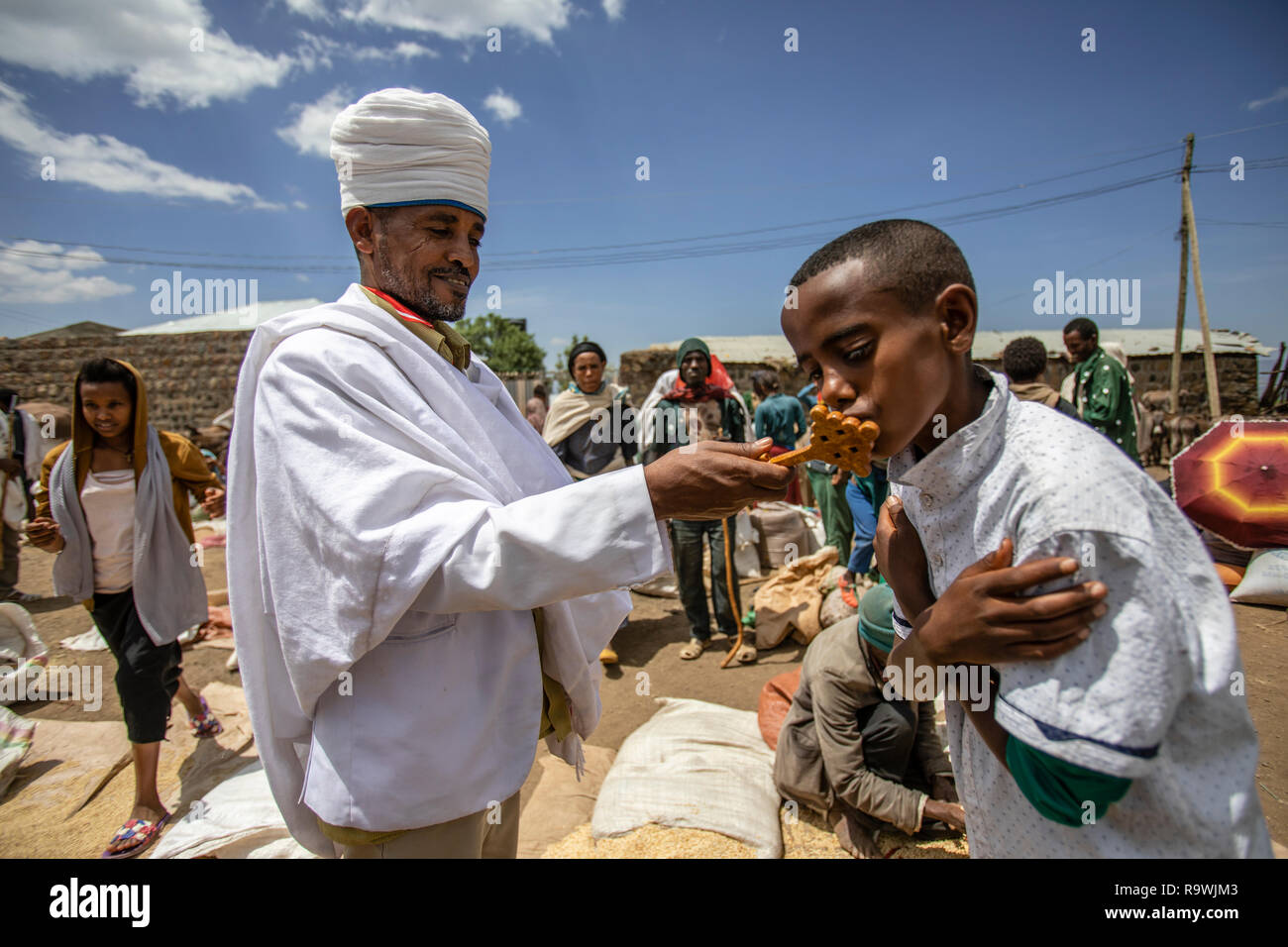 Priest giving blessing at the Lalibela market, Ethiopia - Stock Image