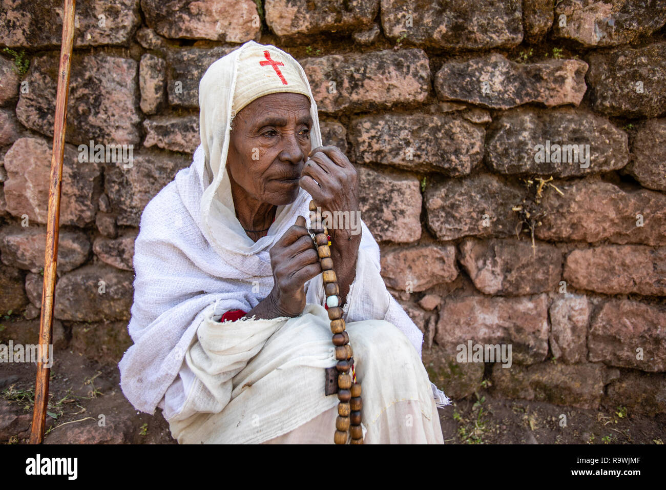 Worshiper at the rock-cut church of House of the Saviour of the World at Lalibela, Ethiopia - Stock Image