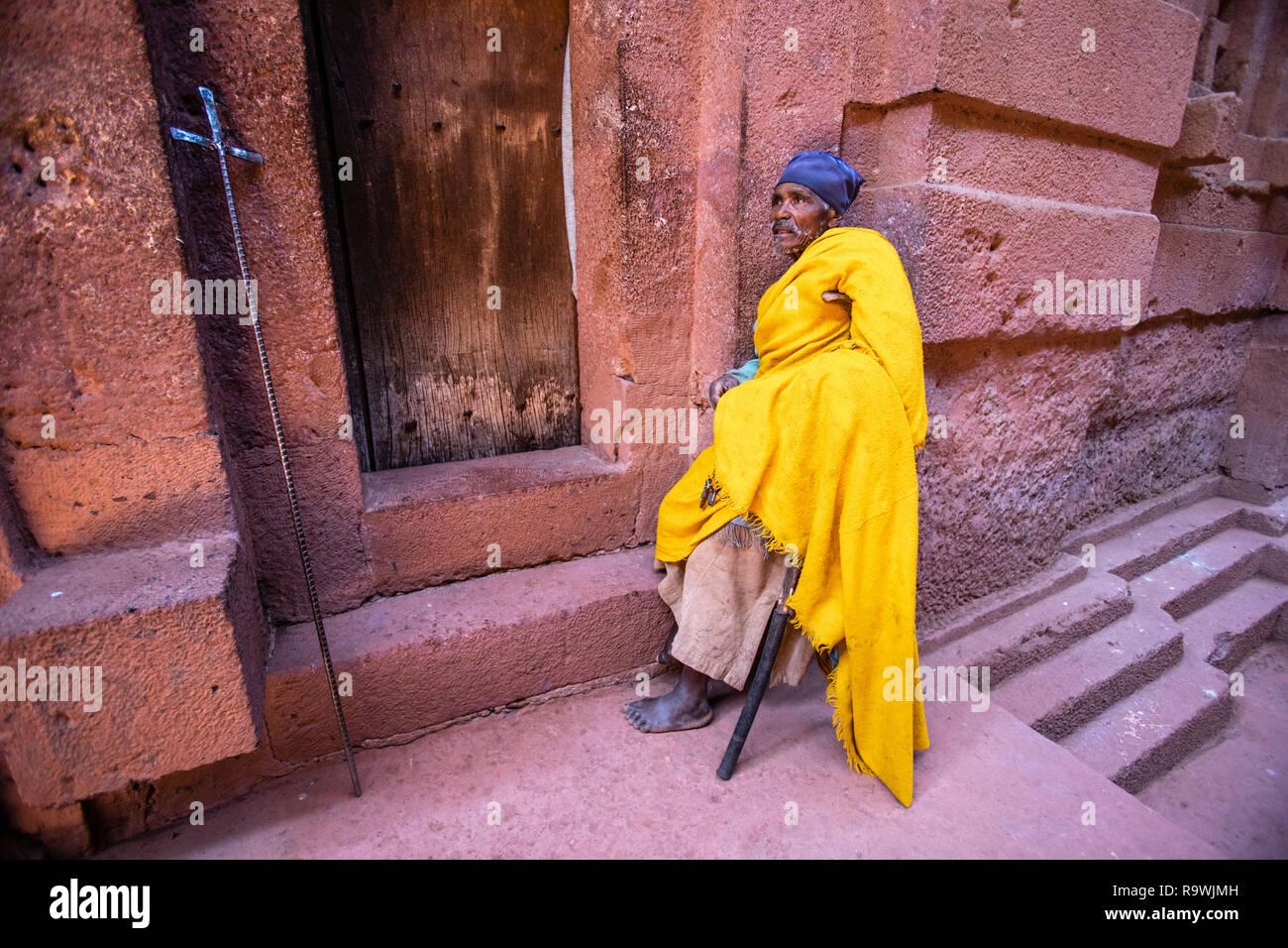 Worshiper at the rock-cut church of House of Immanuel at Lalibela, Ethiopia - Stock Image