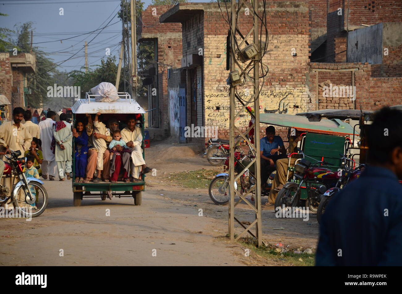 A motorcycle rikshaw or tukuk with people sitting in it. A view from rural Sindh, Pakistan. Stock Photo