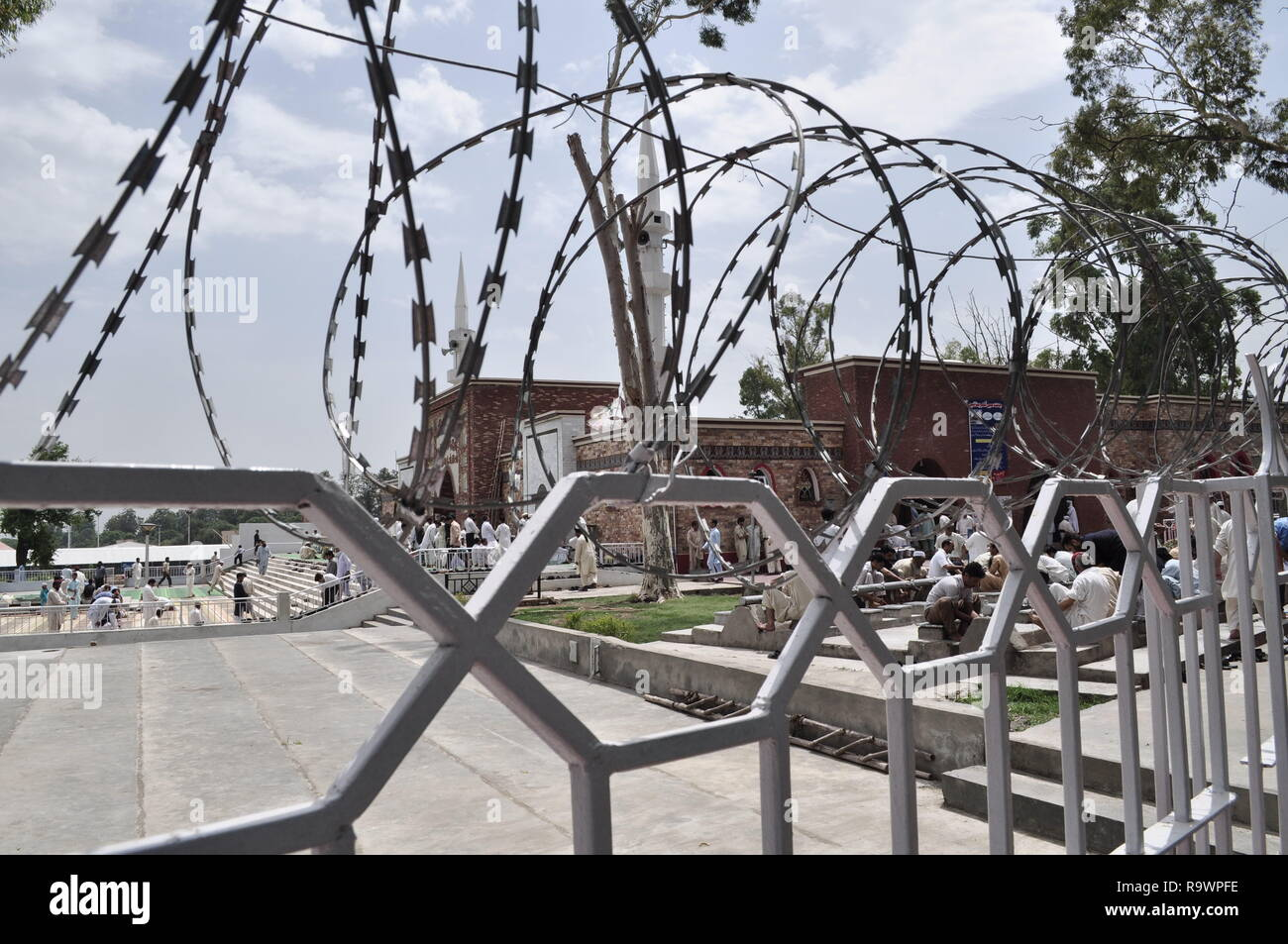Security parameter with a barbed wire outside red mosque islamabad, also known as laal masjid. Stock Photo