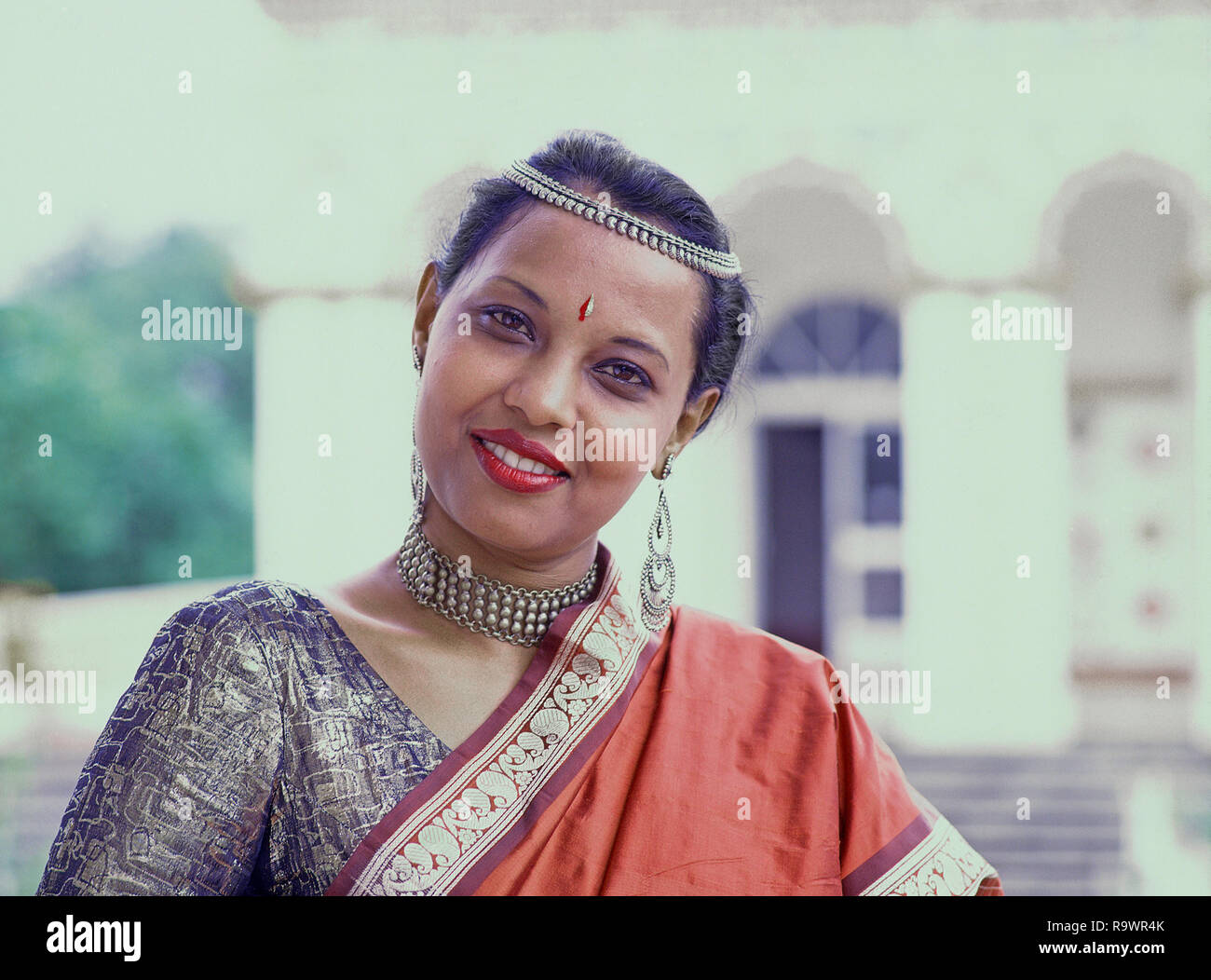 10928d4d3 Young Mauritian woman wearing traditional sari complete with over shoulder  pallu, necklace, decorative earrings