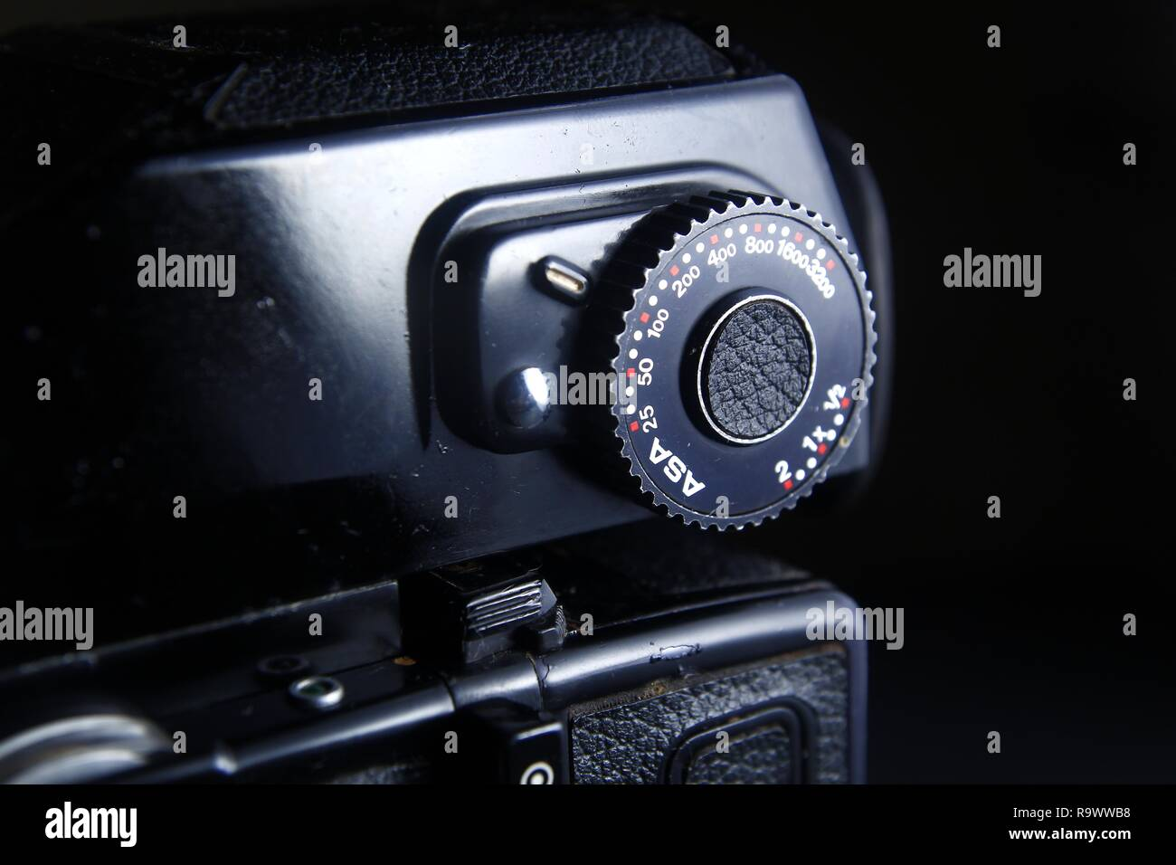 Close up shot of the ISO or ASA rating and exposure compensation dial on an eye level finder of a vintage medium format film camera. - Stock Image