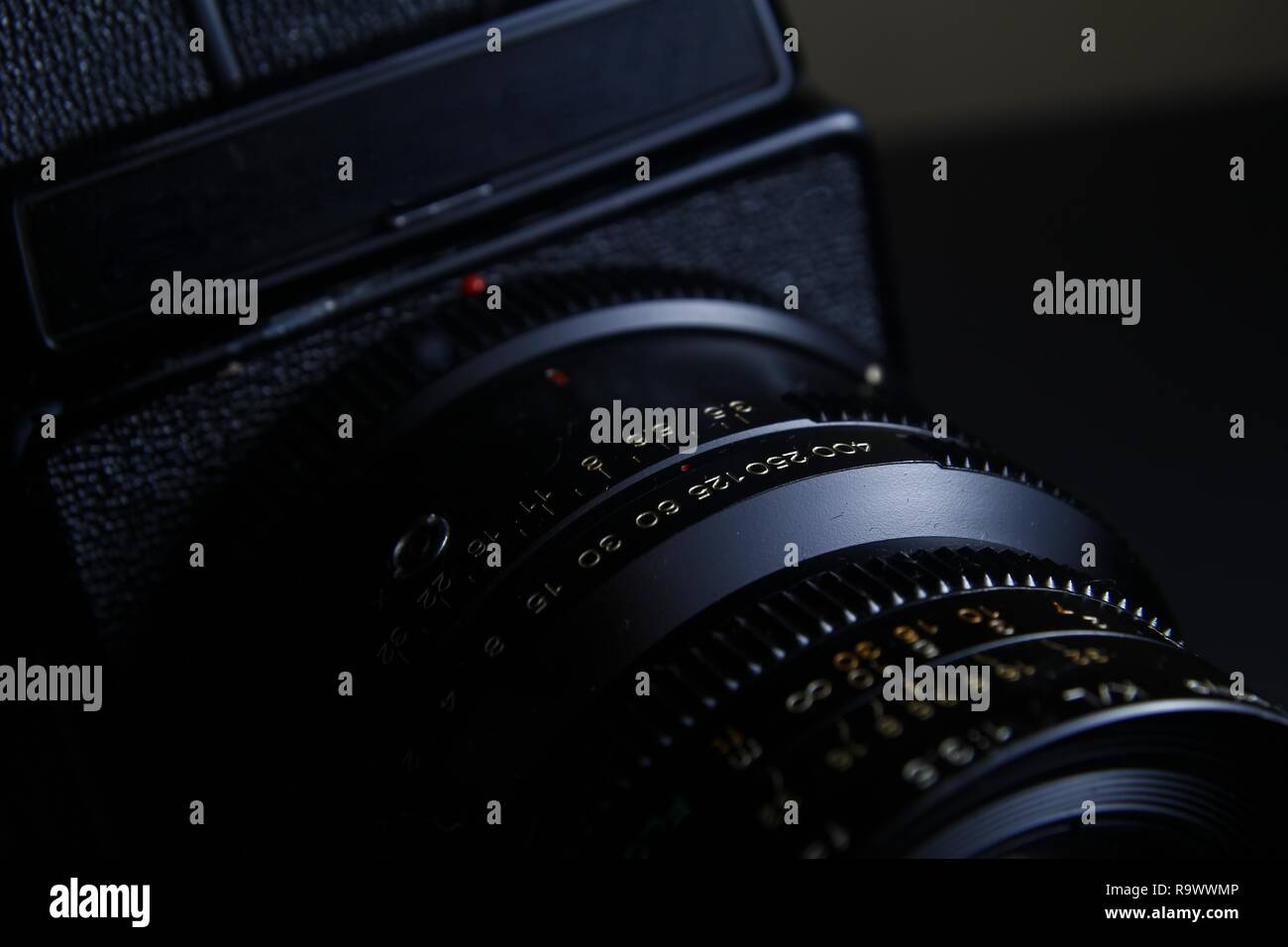 Close up shot of the shutterspeed and aperture ring on the leaf shutter lens of a vintage medium format film camera. Stock Photo