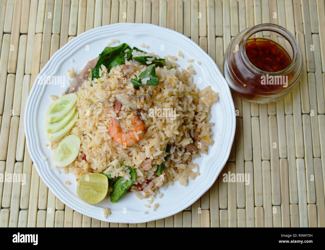 fried rice mixed seafood and pork and glass of fish sauce Stock Photo