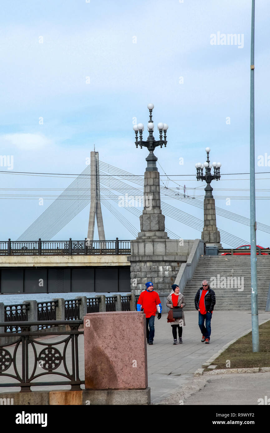 View of the Akmens bridge from the 11th November Embankment. Stairs to the stone bridge and lanterns in Riga, Latvia. Behind the Akmens bridge-  Vansu - Stock Image