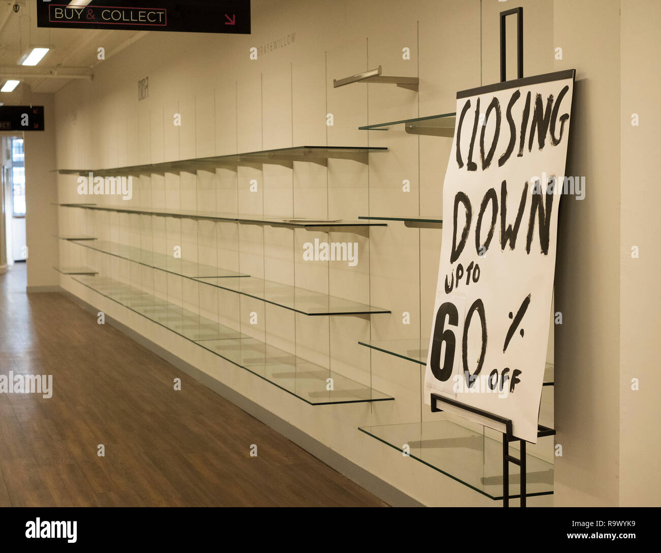 Closing down sign and empty shelves at House of Fraser store, Shrewsbury, England, UK - Stock Image