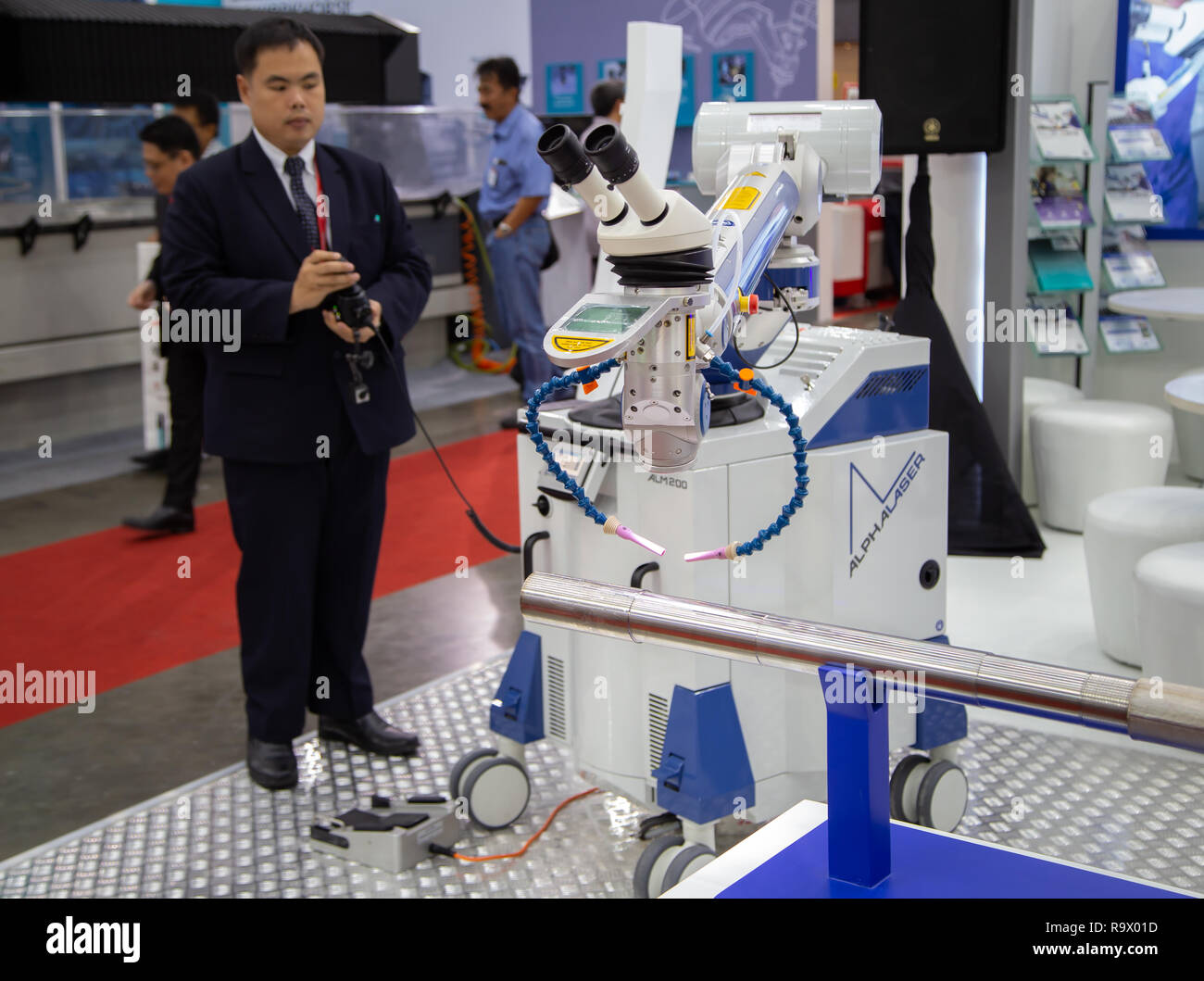 Bangkok, Thailand - November 23, 2018: Worker demonstate laser cutting tube in Metalex 2018 - Stock Image