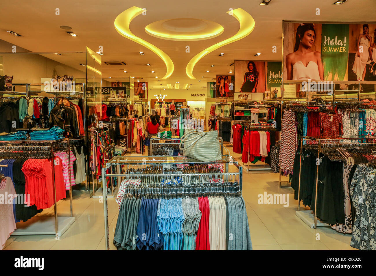 COLOMBO, SRI LANKA - SEPTEMBER 05, 2016:  Wide View of Ladies wear Clothes, Dresses, Skirts, Frocks, Trousers, Jackets, with Shelves, Racks and Hanger - Stock Image