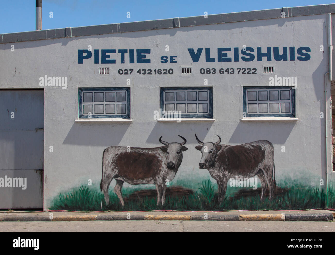 Mural at a facade of a butcher's shop in Lambert's Bay, South Africa - Stock Image