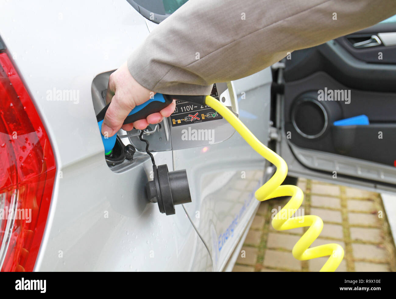 recharge an electric car - Stock Image