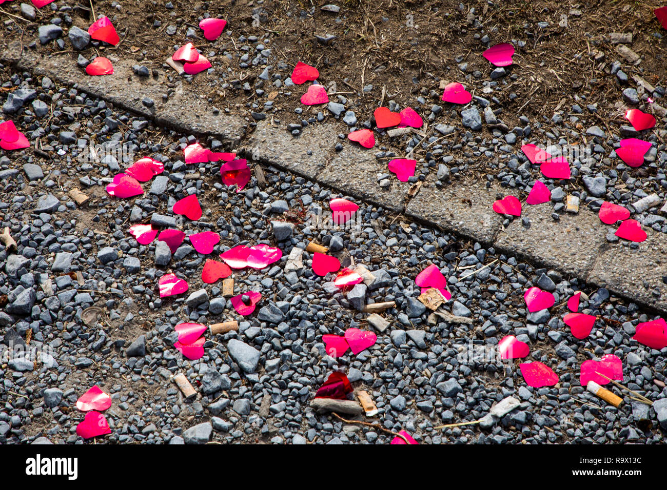 Small, red hearts made of aluminum foil, remnants of a photo shoot after a wedding, at a lookout point, Wartburg, above Heilbronn, - Stock Image