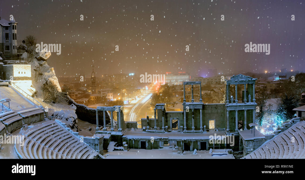 Plovdiv city, Bulgaria, Europe, winter night panoramic photo from one of the hills in the city with ancient roman amphitheater in front. - Stock Image