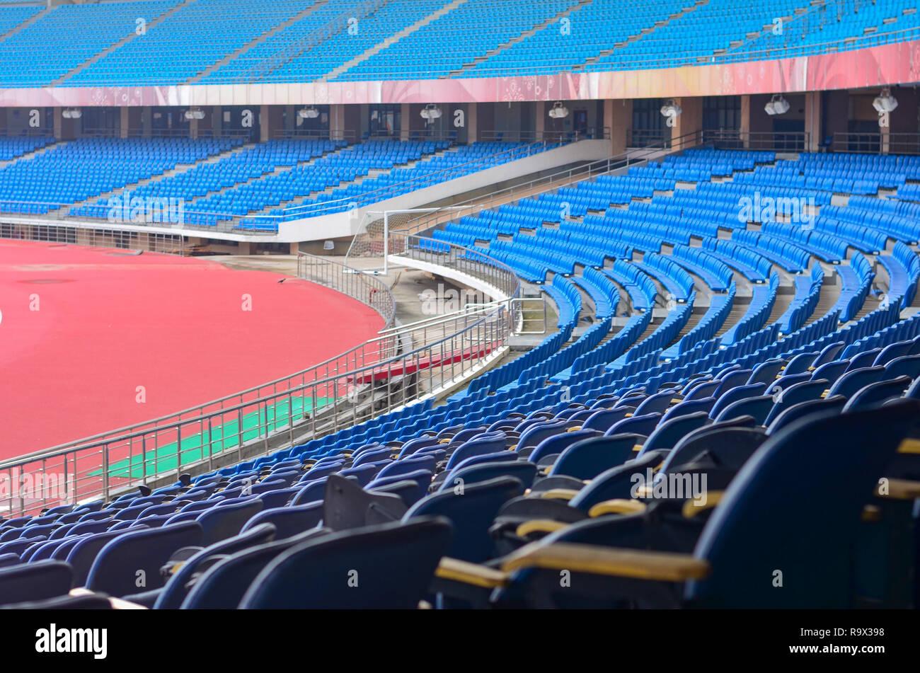 Empty blur seats of Jawaharlal Nehru Stadium (JLN) in Delhi, India - Stock Image