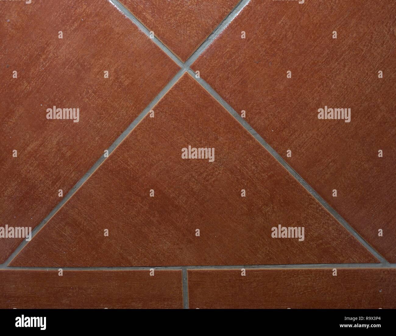 Custom tile bathroom backsplash wall with white  chinks between tiles. Stock Photo