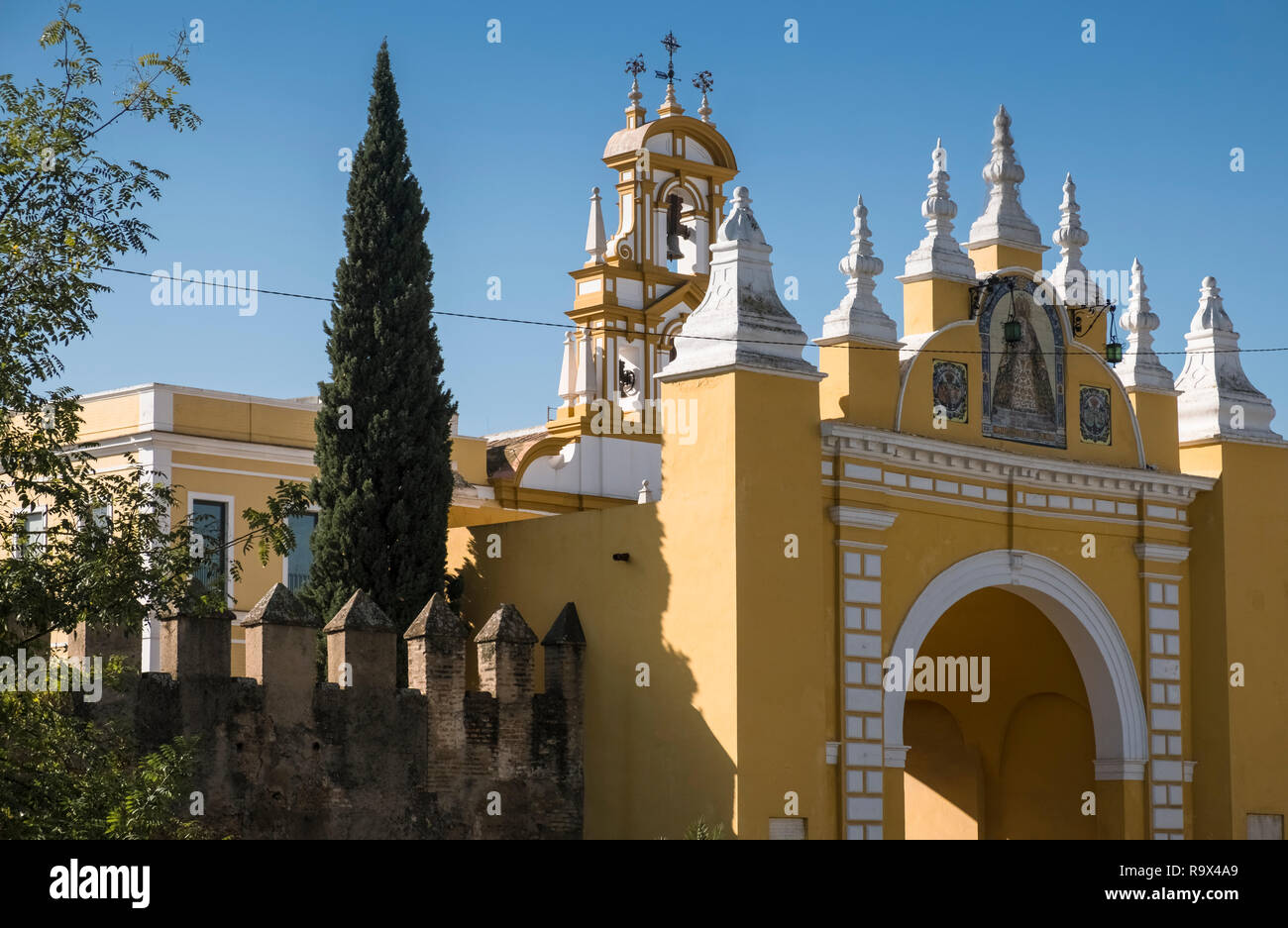 The Macarena Gate, part of the historic city walls, and a working class barrio district in the north eastern region of Seville, Spain. Stock Photo