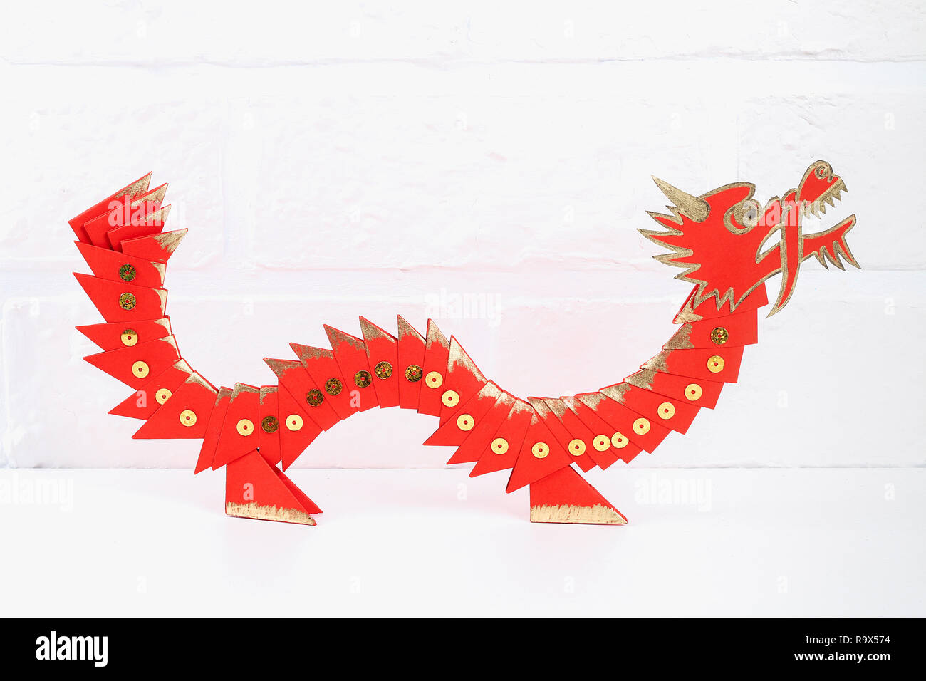 Diy Chinese Dragon On Wall Background Gift Ideas Decor Chinese New Year Handmade Red Gold Lunar Dragon Lion From Modular Origami Step By Step The Stock Photo Alamy