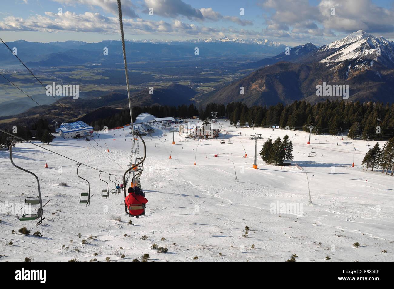people riding a skilift at krvavec alpine mountain ski resort in