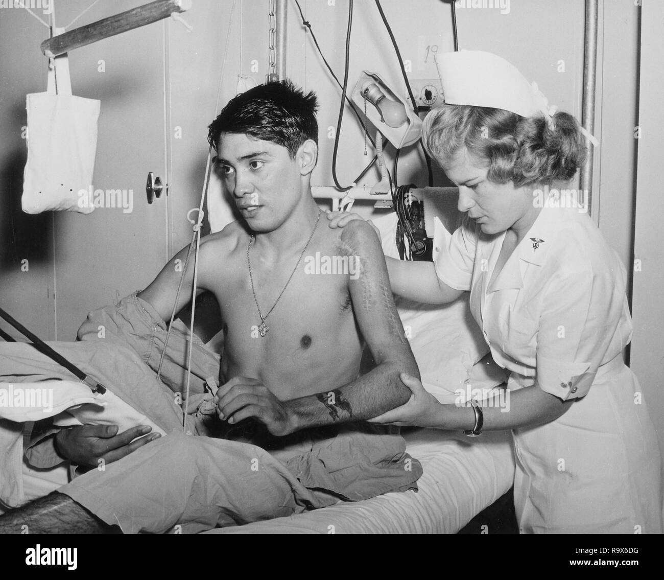 Exercise to Shoulder and Elbow to Increase Motion Following Fracture and Dislocation of Humerous Is Being Given by an Army Therapist to a Soldier Patient., 1940 - 1945 - Stock Image