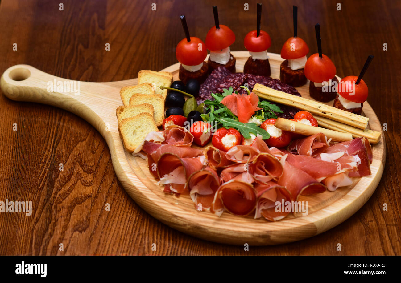 Appetizer Table With Italian Antipasto Snacks Cold Meat Cuts And Canape With Tomatoes Served On Appetizer Platter The Taste From Space Stock Photo Alamy
