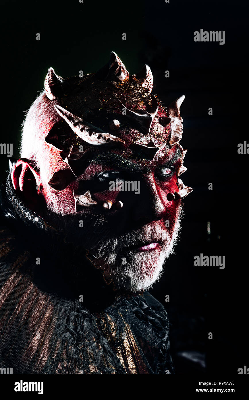 voodoo and black magic. man with evil makeup, voodoo. halloween man with face of devil. power of spell and impossible feats by tricks abracadabra - Stock Image