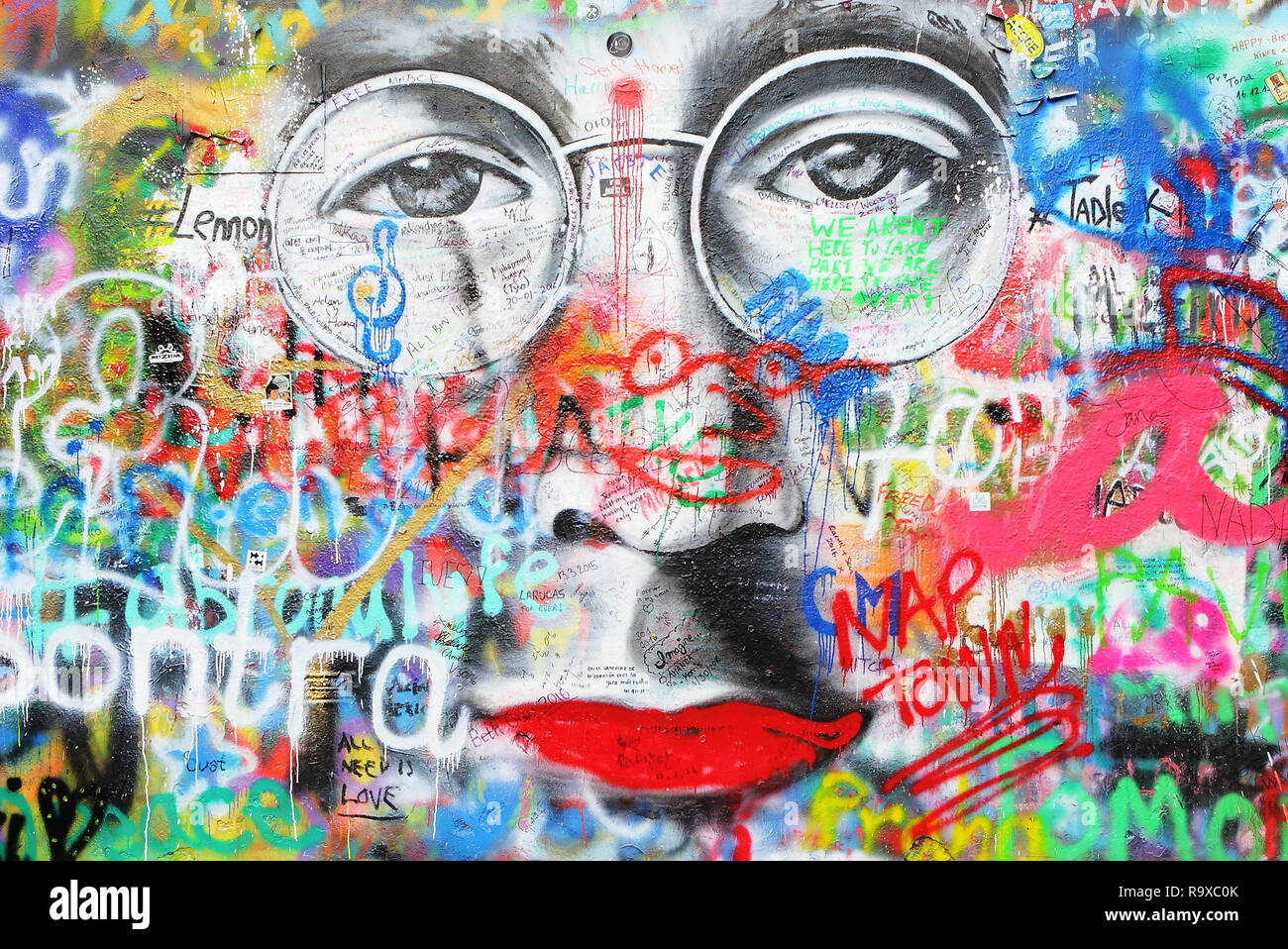 PRAGUE, CZECH REPUBLIC - JANUARY 04: The Lennon Wall since the 1980s is filled with John Lennon-inspired graffiti and pieces of lyrics from Beatles so - Stock Image