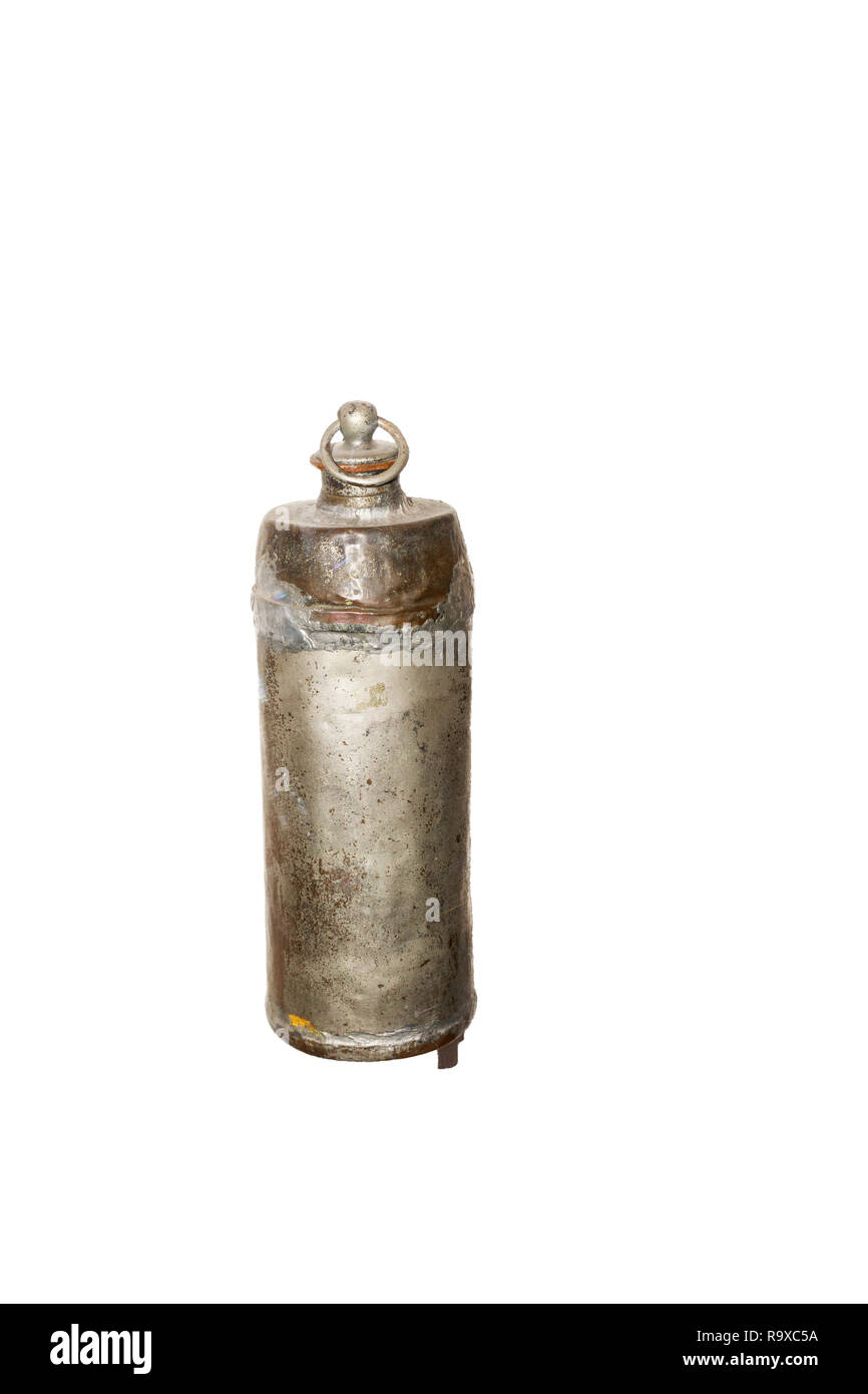 Old hot water bottle made of metal - bed warming bottle - big bottle-shaped form with cork closure - Stock Image
