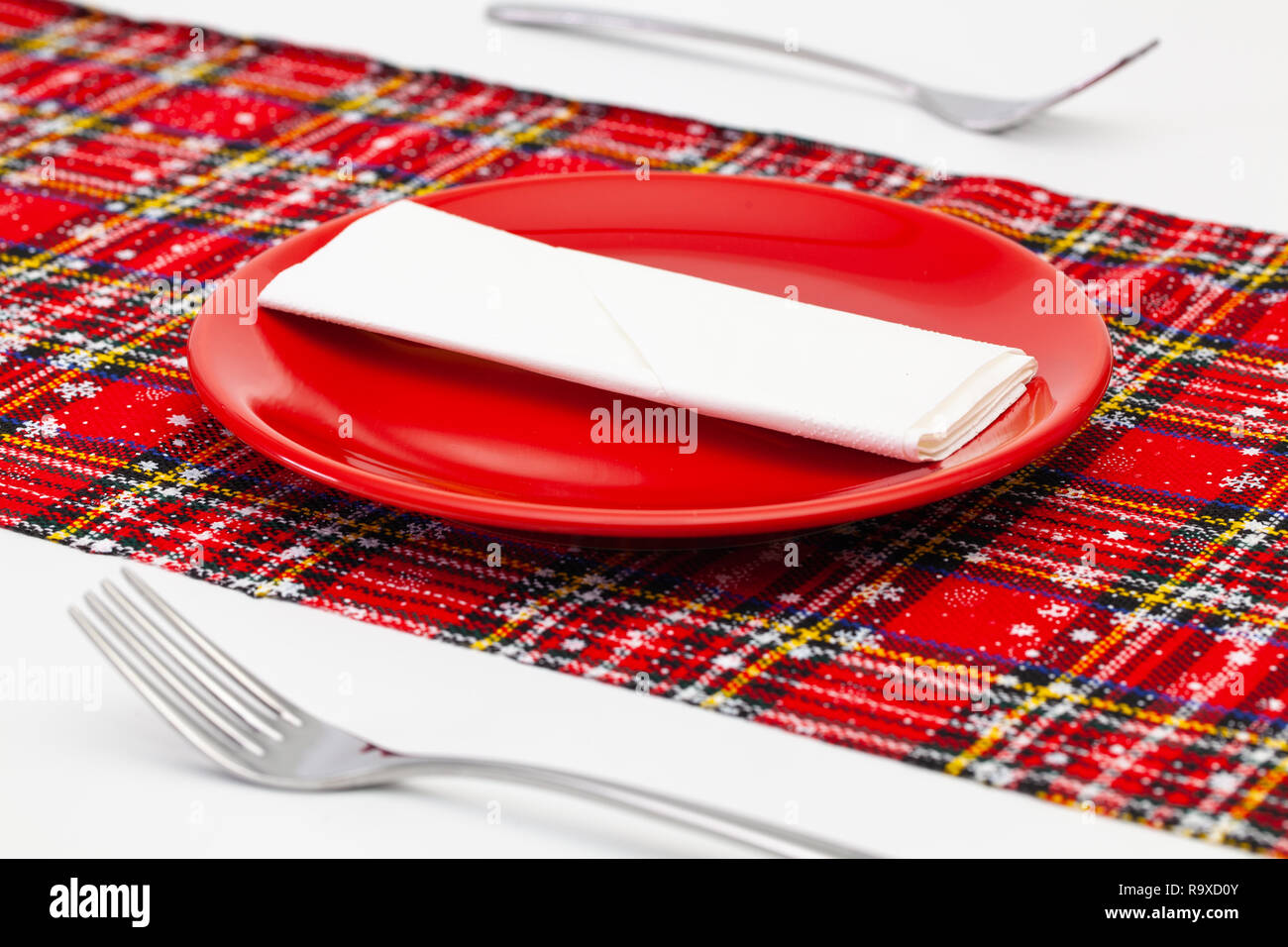 Wondrous Red Plate And Christmas Decoration On The White Wooden Table Download Free Architecture Designs Grimeyleaguecom