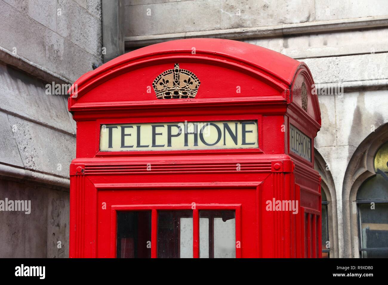 London phone boxes - red telephone kiosk in the UK. - Stock Image