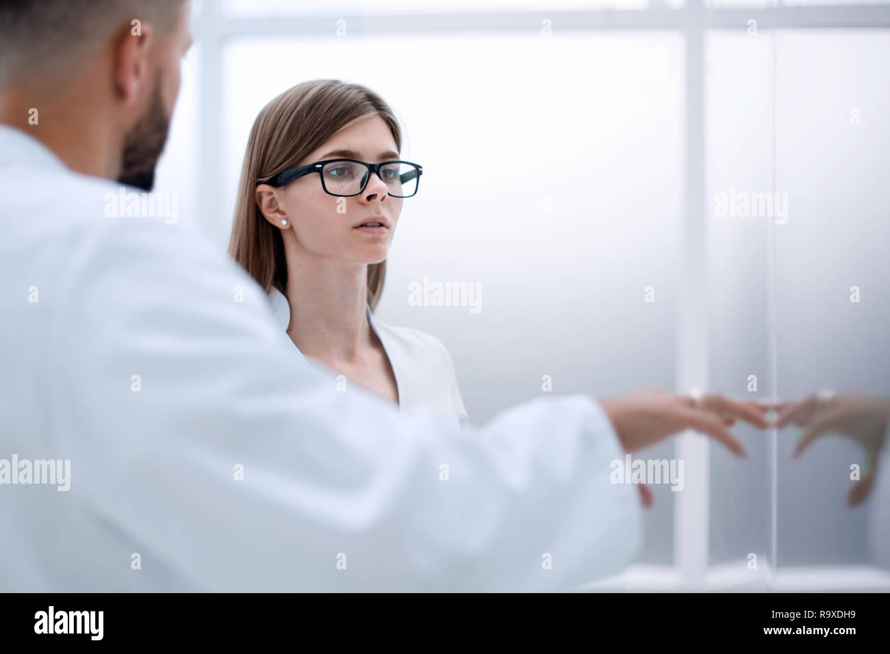 A busy team of experts in forensic science. - Stock Image