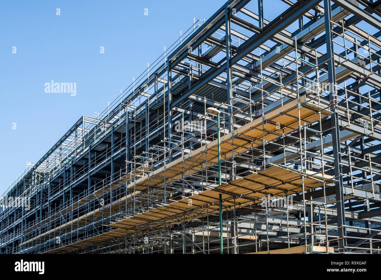 Scaffolding platform on a steel girder framework for a new building on a construction site, Nottingham, England, UK - Stock Image