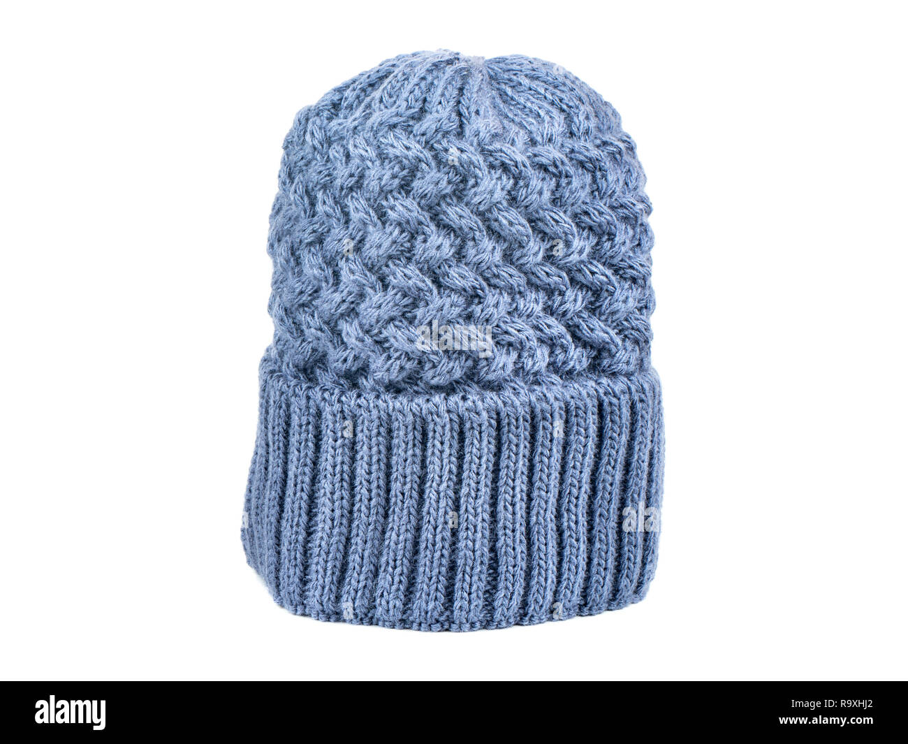 b67ea7eec77 Blue knitted winter womens hat on white background Stock Photo ...