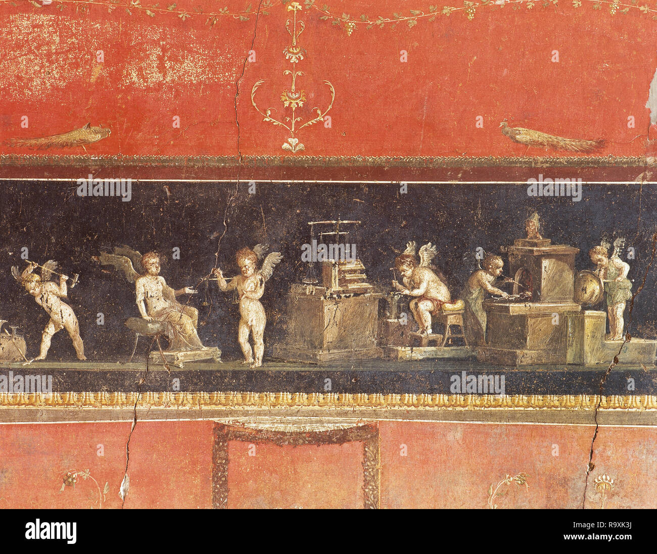 Italy. Pompeii. Triclinium of The House of the Vettii. Frieze of the Cupids or Cherubs. Painting of Cupids doing goldsmith work. 1st century AD. Campania. - Stock Image