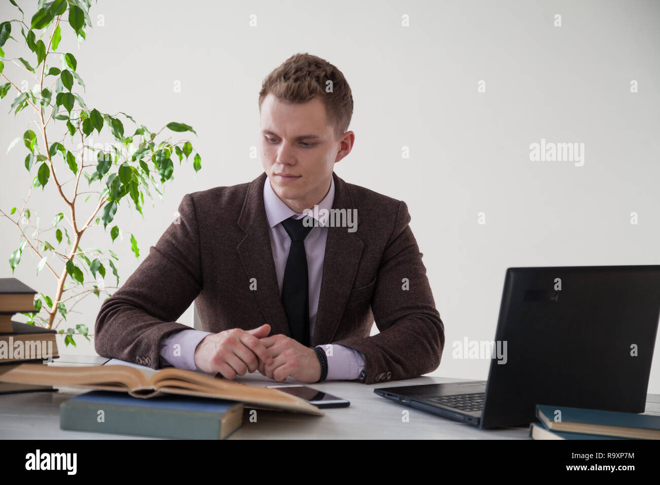 a man works in the Office at the computer business clerk  - Stock Image