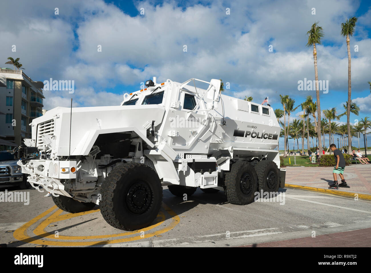 MIAMI - CIRCA DECEMBER, 2017: An armored police vehicle stands guard at Ocean Drive protecting crowds of pedestrians gathered for the holidays. - Stock Image