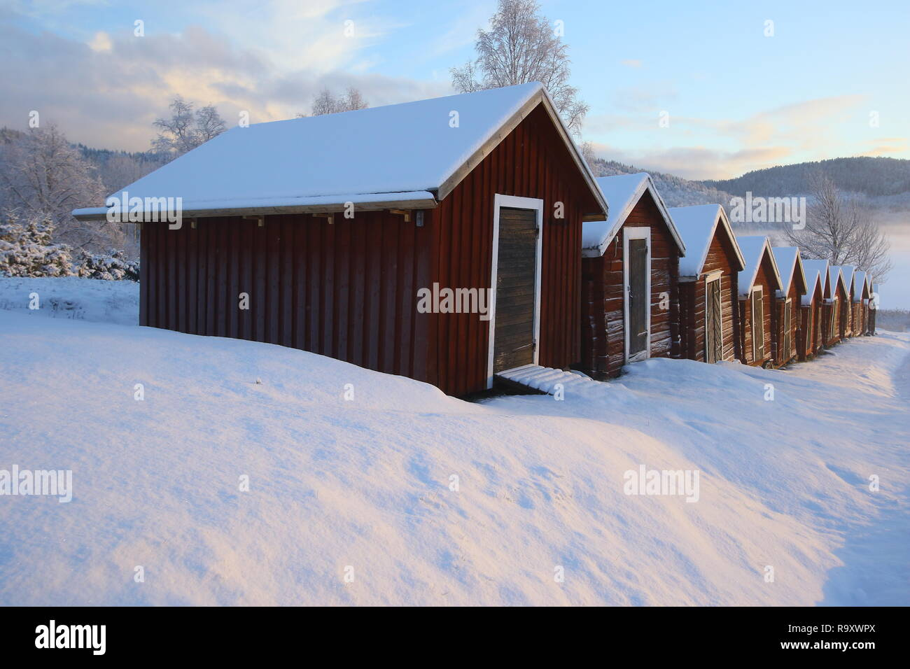 Höga Kusten view in wintertime sun is low there is a great light the tranquility at the lake slow down slow travel the hectic time go back to nature - Stock Image