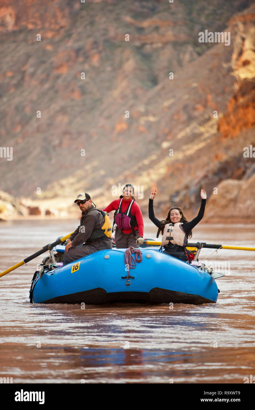 Smiling group of friends rafting on a river. - Stock Image