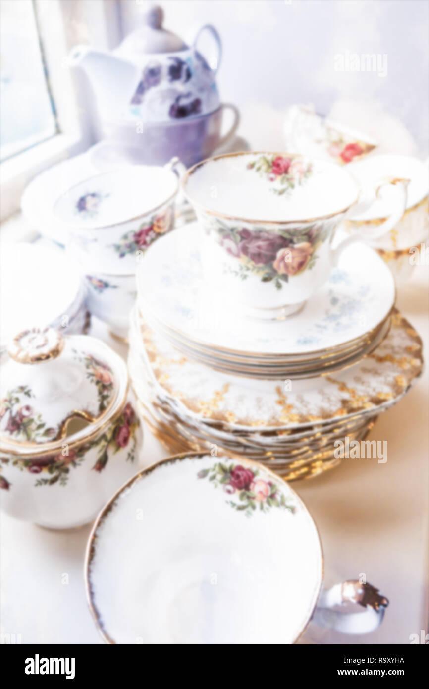 A stack of fine vintage English bone china crockey.