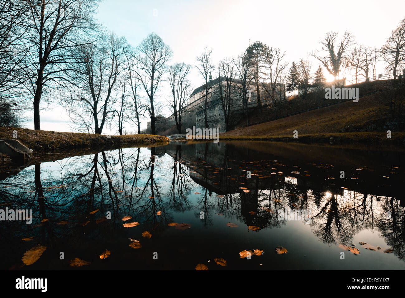 sunrise impression of Castle Forchtenstein (Burgenland, Austria) during winter in a reflecting lake - Stock Image