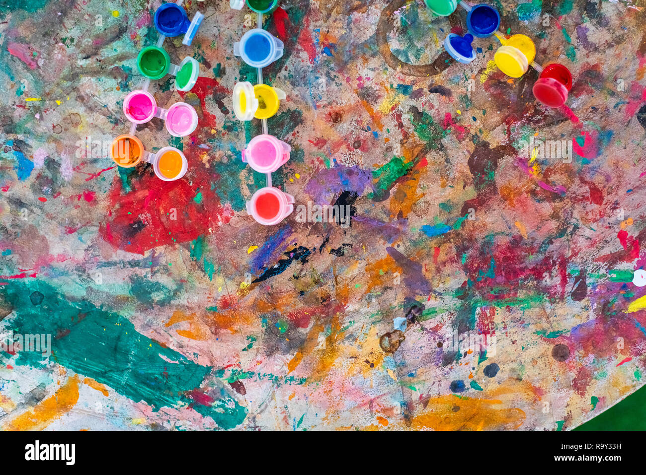 Background Paint Cans On Table Stained Many Colors Stock Photo