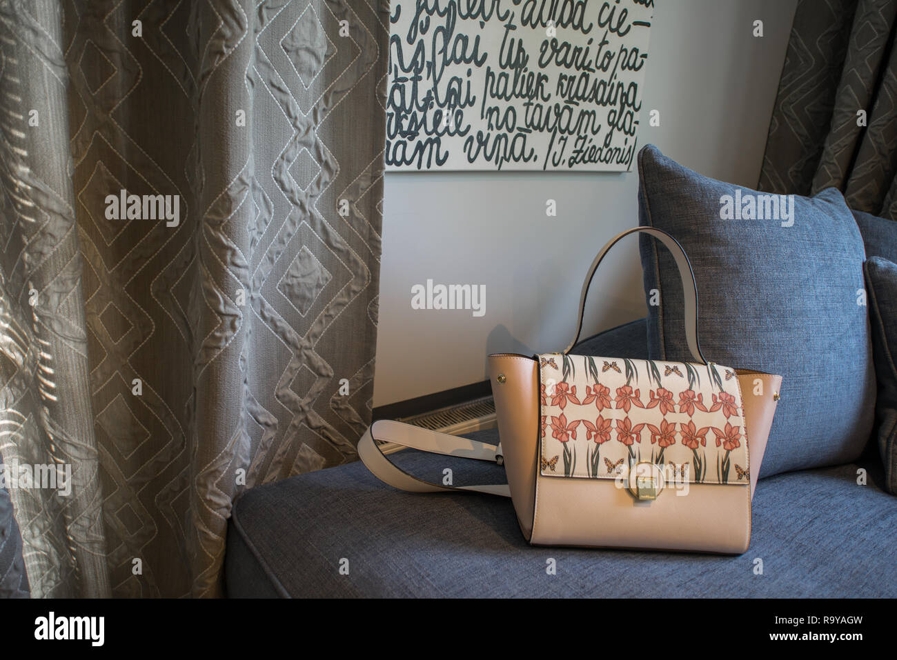 Interior decor, bag and sofa. - Stock Image