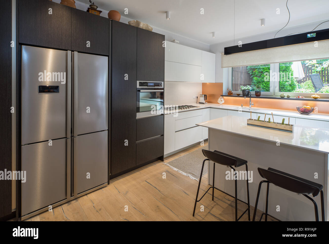 Kitchen in the house. Modern interior. Domestic things. Stock Photo