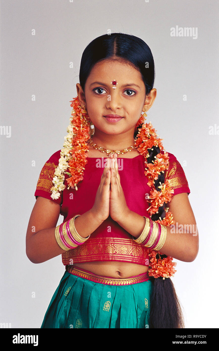 96249eb63a552 South Indian young girl in traditional costume doing namaste Stock ...