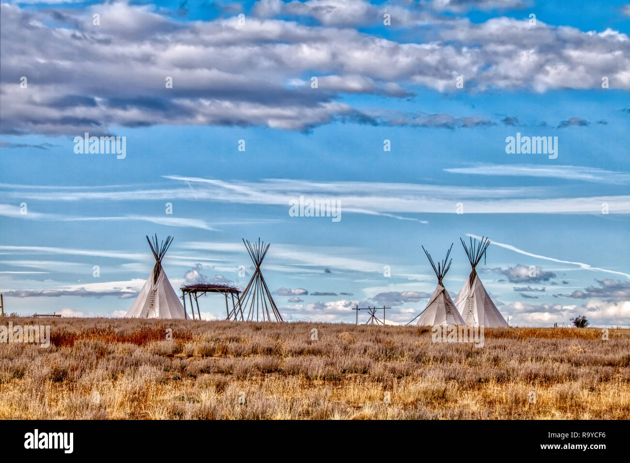Teepees set up for educational purposes demonstrating the lifestyle of early native Americans on the plains of middle America. - Stock Image