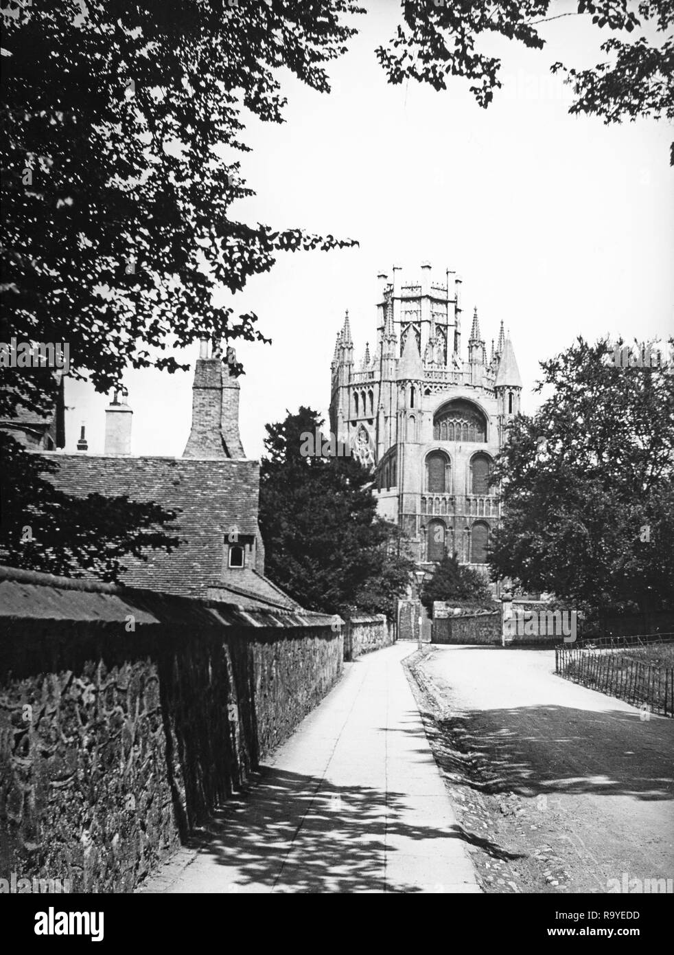 Late Victorian black and white photograph of Ely Cathedral in Cambridgeshire, England.The cathedral has its origins in AD 672 when St Etheldreda built an abbey church. The present building dates back to 1083, and cathedral status was granted it in 1109. Until the Reformation it was the Church of St Etheldreda and St Peter, at which point it was refounded as the Cathedral Church of the Holy and Undivided Trinity of Ely, continuing as the principal church of the Diocese of Ely, in Cambridgeshire. - Stock Image