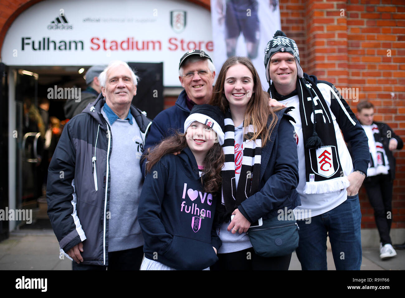 Fulham fans arrive at the ground ahead of the Premier League match at Craven Cottage, London. - Stock Image