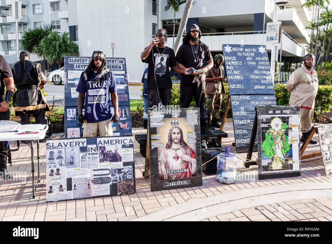 Miami Beach Florida Lummus Park free speech speaking speaker ISPUK Israelite School of Universal Practical Knowledge Black man signs - Stock Image