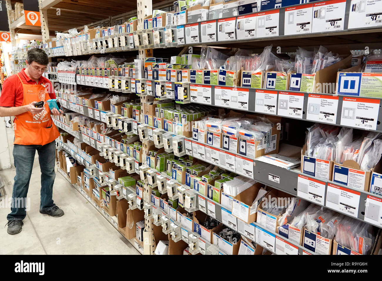 Miami Florida The Home Depot inside hardware big box store do it yourself outlet switch nylon plates sale display shelves man employee stock clerk sho - Stock Image