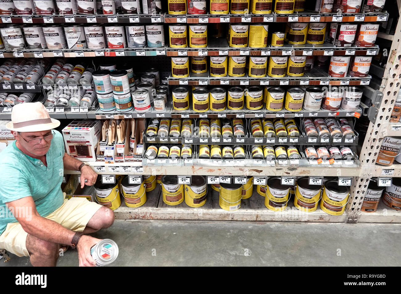Miami Florida The Home Depot inside hardware big box store do it yourself shopping display sale shelves wood stain Varathane man customer looking read - Stock Image